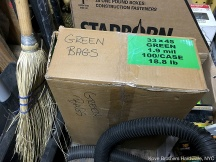 closed box of green trash basket liners